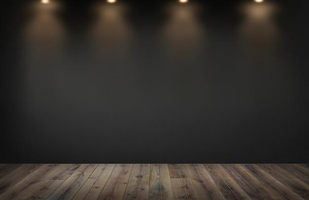 空の部屋でスポットライトの行と黒い壁 Premium写真