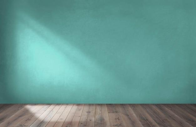 Зеленая стена в пустой комнате с деревянным полом Бесплатные Фотографии