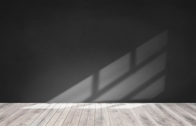 木製の床と空の部屋で黒い壁 無料写真