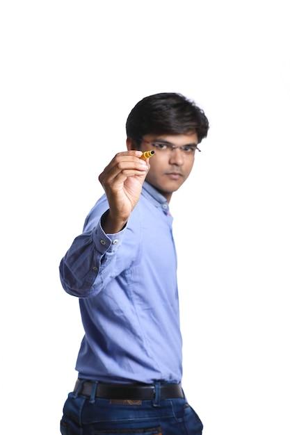 マーカーペンと書くとインド人 Premium写真