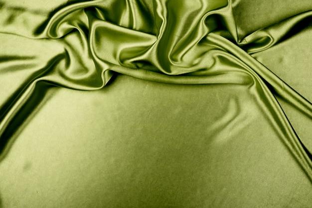 背景の緑の高級サテン生地の質感 Premium写真