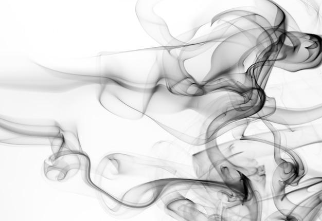 白い背景、火のデザインに黒い煙抽象 Premium写真