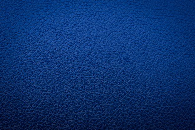 背景、ソファの概要のための青い革の質感 Premium写真