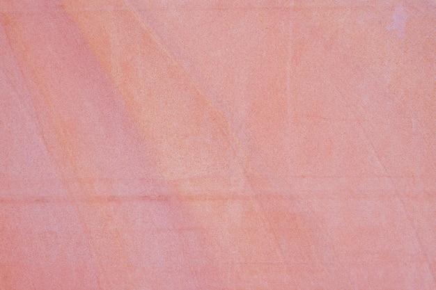 Старая красная предпосылка текстуры каменной стены песка. Premium Фотографии