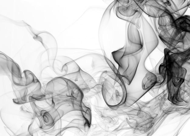 黒は白い背景の煙。抽象芸術。有毒運動 Premium写真