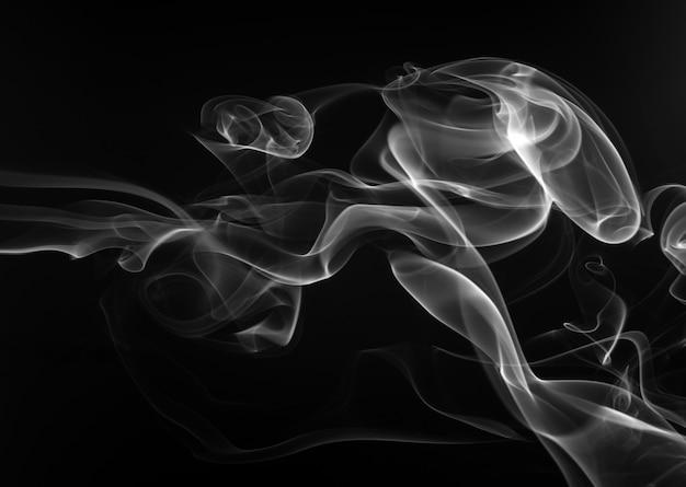 黒い背景に白い香を吸う。闇の概念 Premium写真