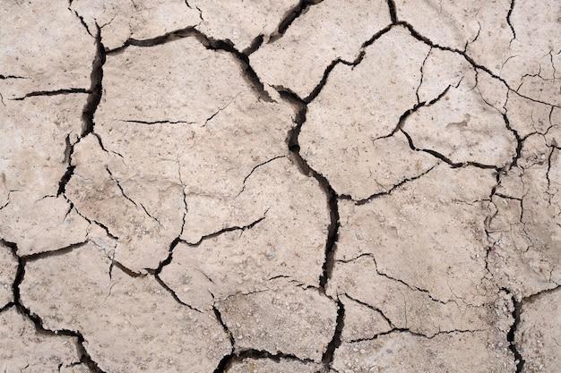 Почва засухи потрескавшаяся текстура натур фон Premium Фотографии