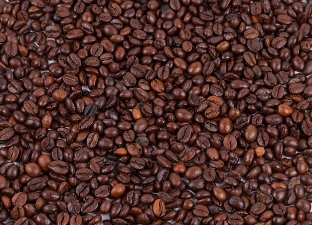 背景として使用される焙煎コーヒー豆のテクスチャ Premium写真