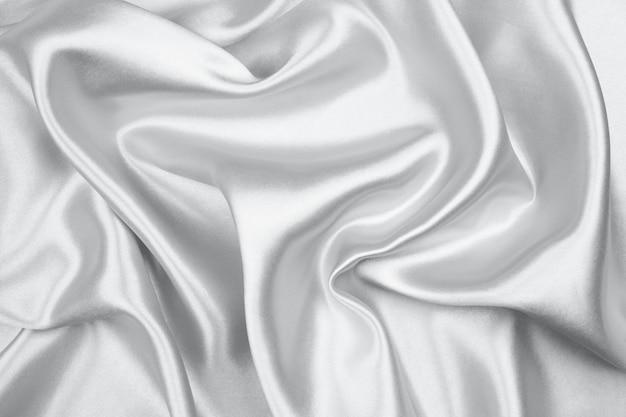 Серебристая шелковая текстура роскошного атласа для абстрактного фона Premium Фотографии