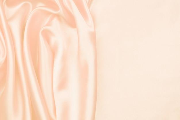 抽象的な背景のクリームシルクのテクスチャ豪華なサテン Premium写真