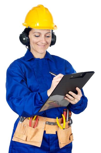 レディ建設労働者は、メモ帳の上に白い背景 Premium写真