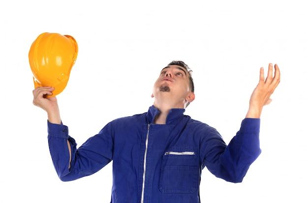 Взволнованный строитель с желтым шлемом Premium Фотографии