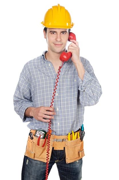 建設労働者は、電話で話す白い背景 Premium写真