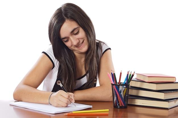 魅力的な女の子の学生以上の白い背景 Premium写真