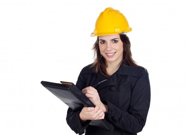 白い背景の上に魅力的な若いエンジニア Premium写真