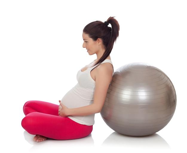 ピラティスをやっている美しい妊婦 Premium写真