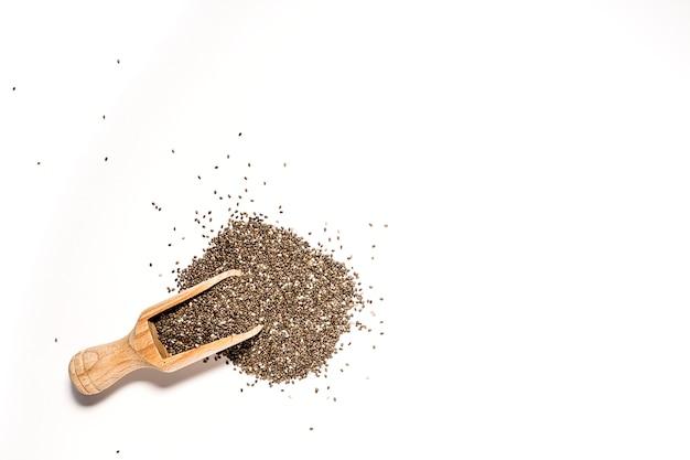 Семя чиа на деревянной доске Premium Фотографии