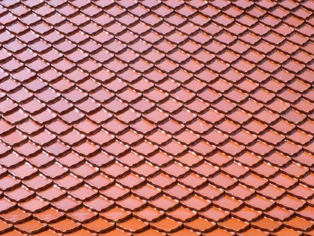 赤いタイル屋根の背景 Premium写真