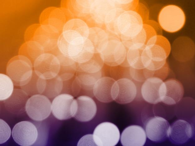 ピンぼけライトと黄色のクリスマスの背景 Premium写真