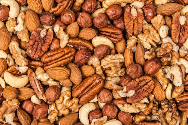 Микс из разных орехов крупным планом Premium Фотографии