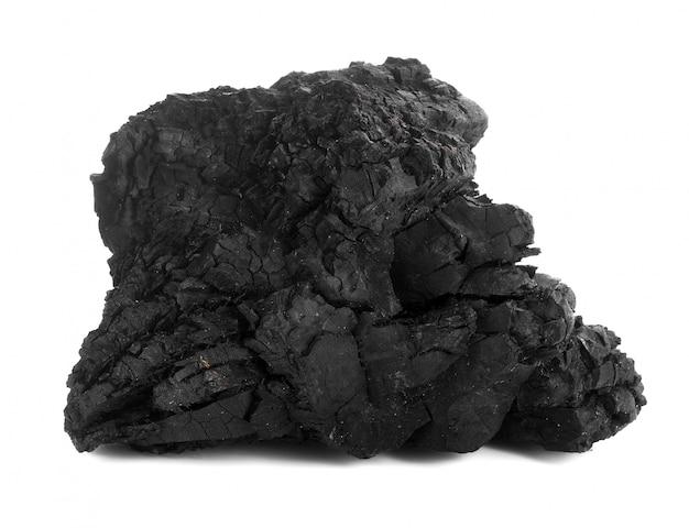 広葉樹炭を白で隔離されます。 Premium写真
