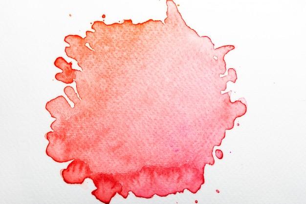 紙の上の抽象的な赤い水彩画 Premium写真