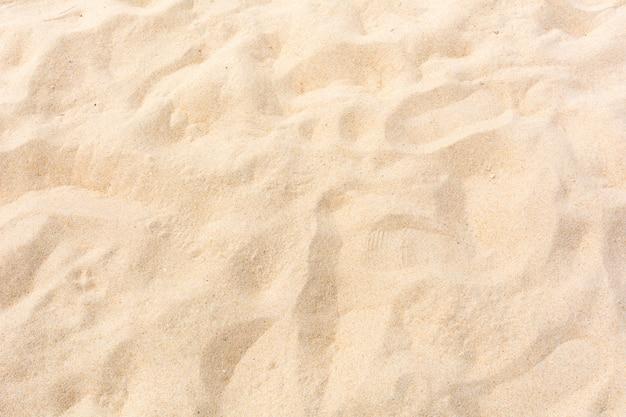 Песчаная природа на пляже в качестве фона Premium Фотографии