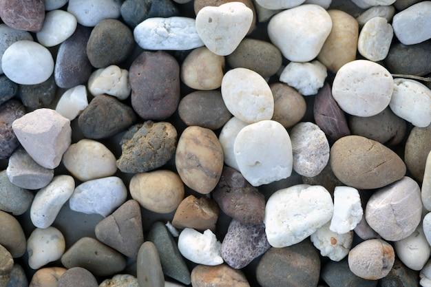背景画像は、石の形と色を混ぜた石の模様です。 Premium写真