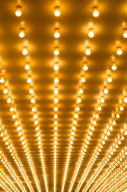 電球マーキーライトの背景 Premium写真
