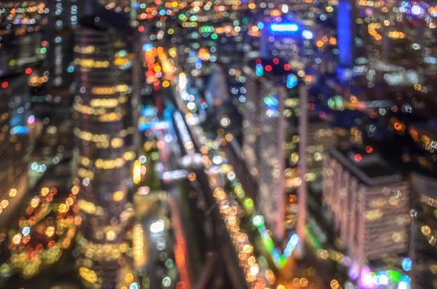 Городской ночной свет боке Premium Фотографии
