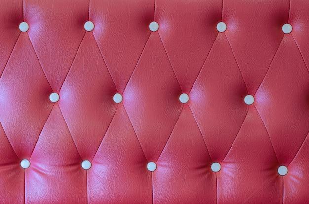 赤い革張りのソファの背景 Premium写真