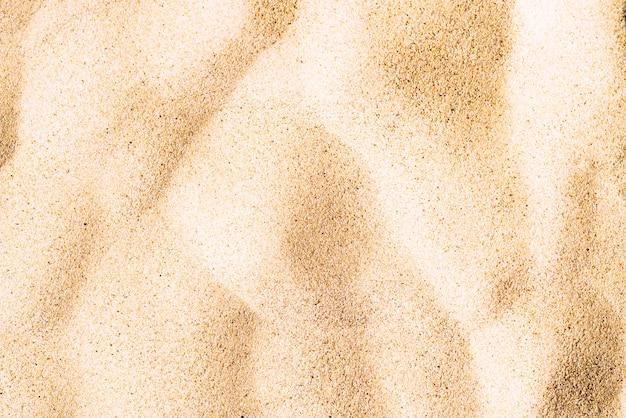 ビーチの細かい砂のテクスチャ 無料写真