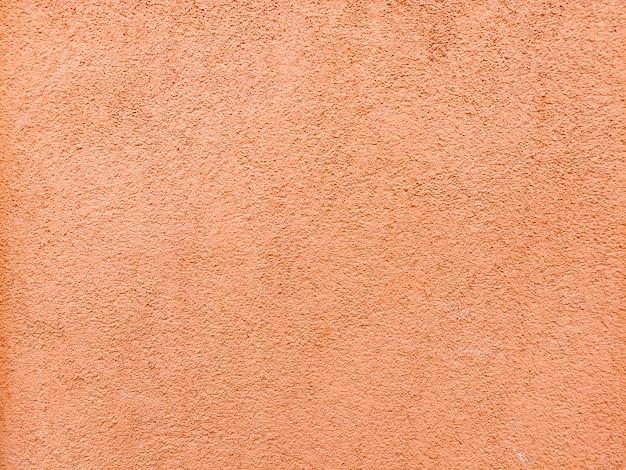 オレンジ色のテクスチャ壁 無料写真