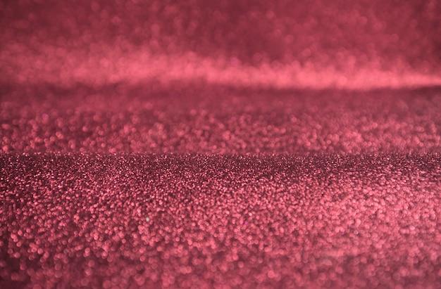 ピンクのグリッターゴールドボケライトの背景 無料写真