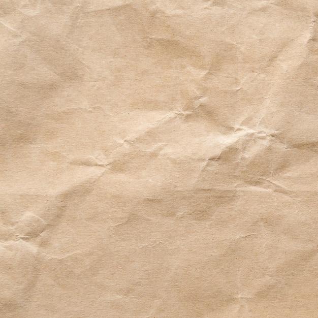 茶色のしわくちゃの紙のテクスチャ背景。 Premium写真