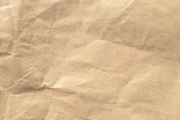 茶色のしわくちゃの紙のテクスチャの背景。 Premium写真