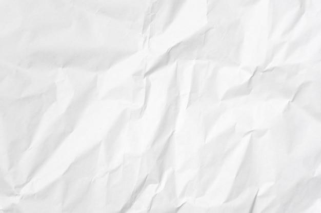 白い背景に紙のテクスチャを巻いた。 Premium写真