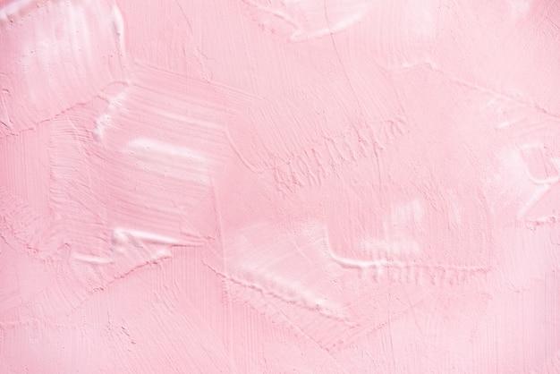 壁のテクスチャ背景にピンクのペンキ Premium写真