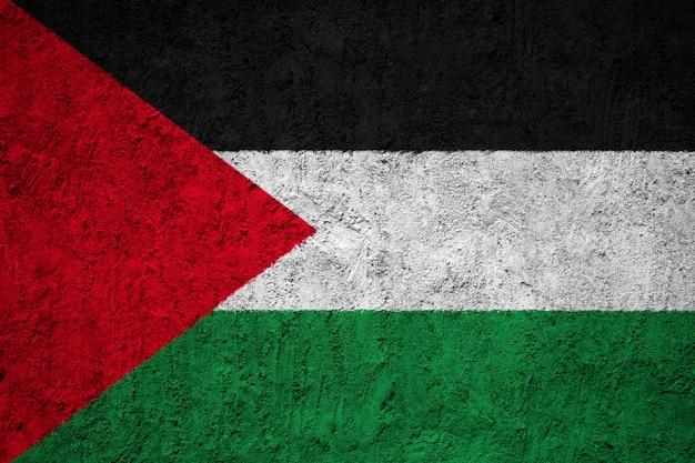 コンクリートの壁にパレスチナの国旗を塗った Premium写真