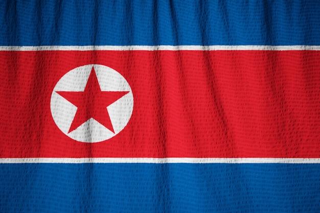 北朝鮮の旗、北朝鮮の旗が風に吹き込む Premium写真