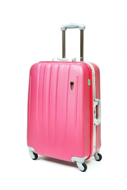 分離されたピンクの旅行荷物 Premium写真