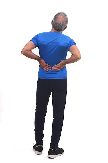 白の背中に痛みを持つ男の背中の完全な肖像画 Premium写真