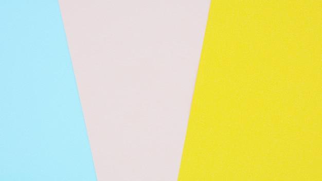 ピンク、イエロー、ブルーの紙の質感 Premium写真