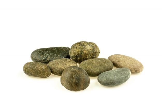別の石と白で隔離される小石の山 Premium写真