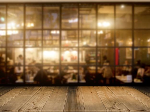 夜のカフェクラブの背景を持つ木製テーブルトップカウンター Premium写真