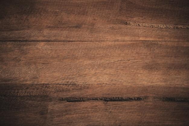 Старый гранж темный текстурированный деревянный фон. Premium Фотографии