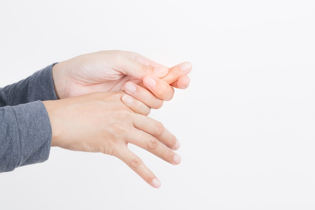 白い背景に女性の手の痛み、健康と病気の概念、末梢神経障害 Premium写真