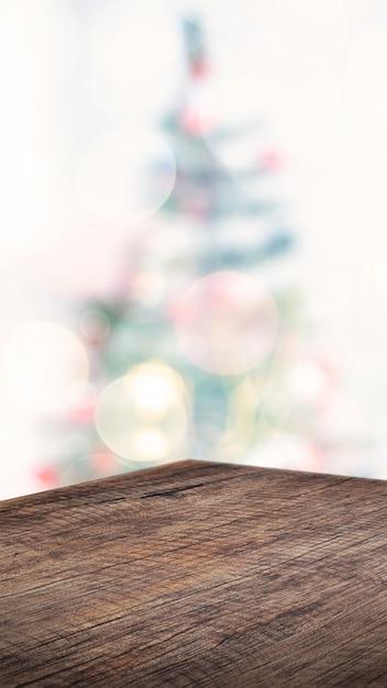 Пустой угол коричневый деревянный стол с абстрактной елкой декора строки свет размытие фона Premium Фотографии