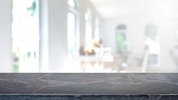 Пустая черная мраморная каменная столешница и запачканная предпосылка интерьера кофейни и ресторана. Premium Фотографии