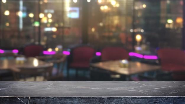 空の黒い大理石の石のテーブルトップの抽象的なぼやけたレストランとナイトクラブのライト Premium写真
